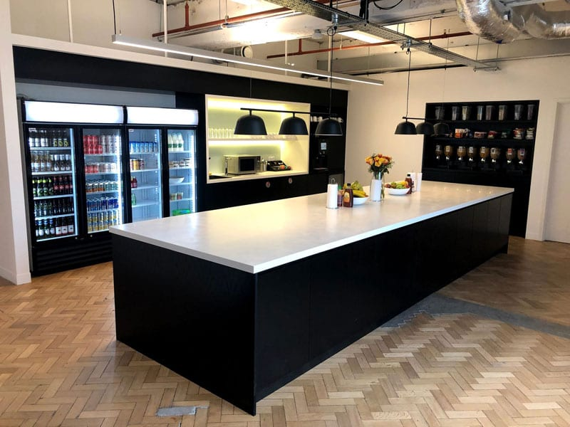 The Cloudflare kitchen with drinks fridges and a central island for catering