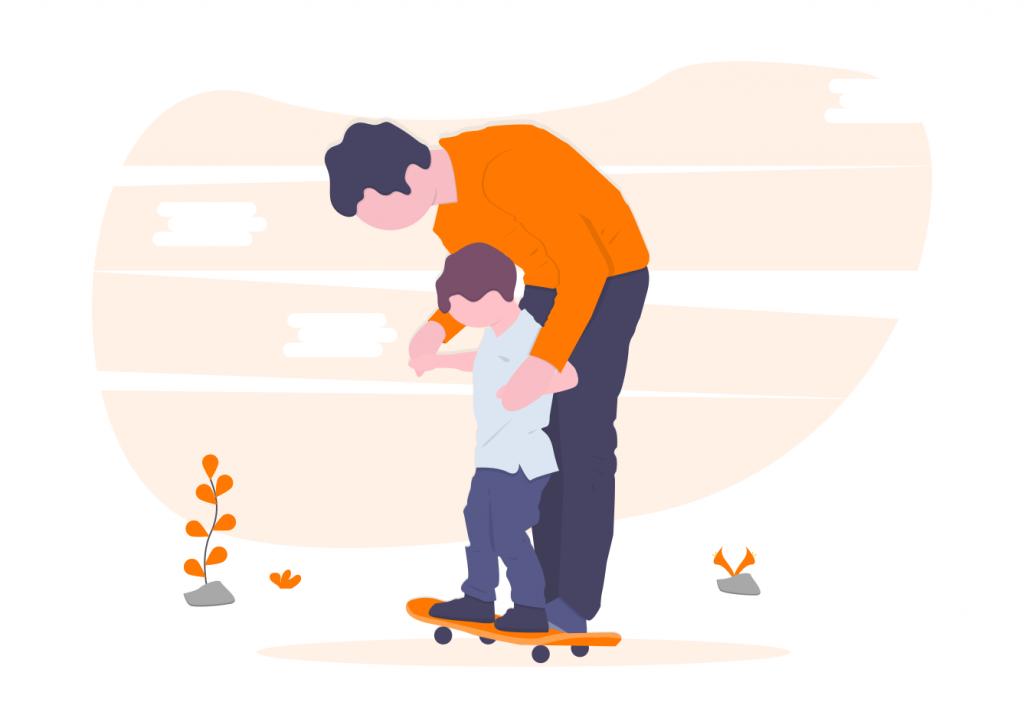 father teaching son to skateboard
