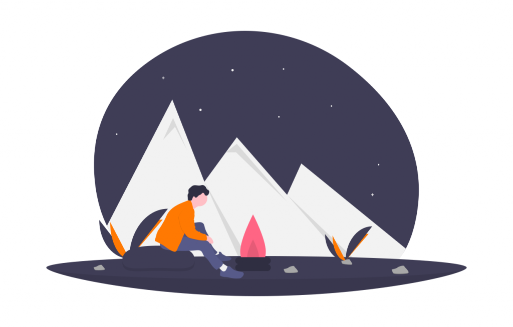 lone person outside at night with a campfire, mountains in the background