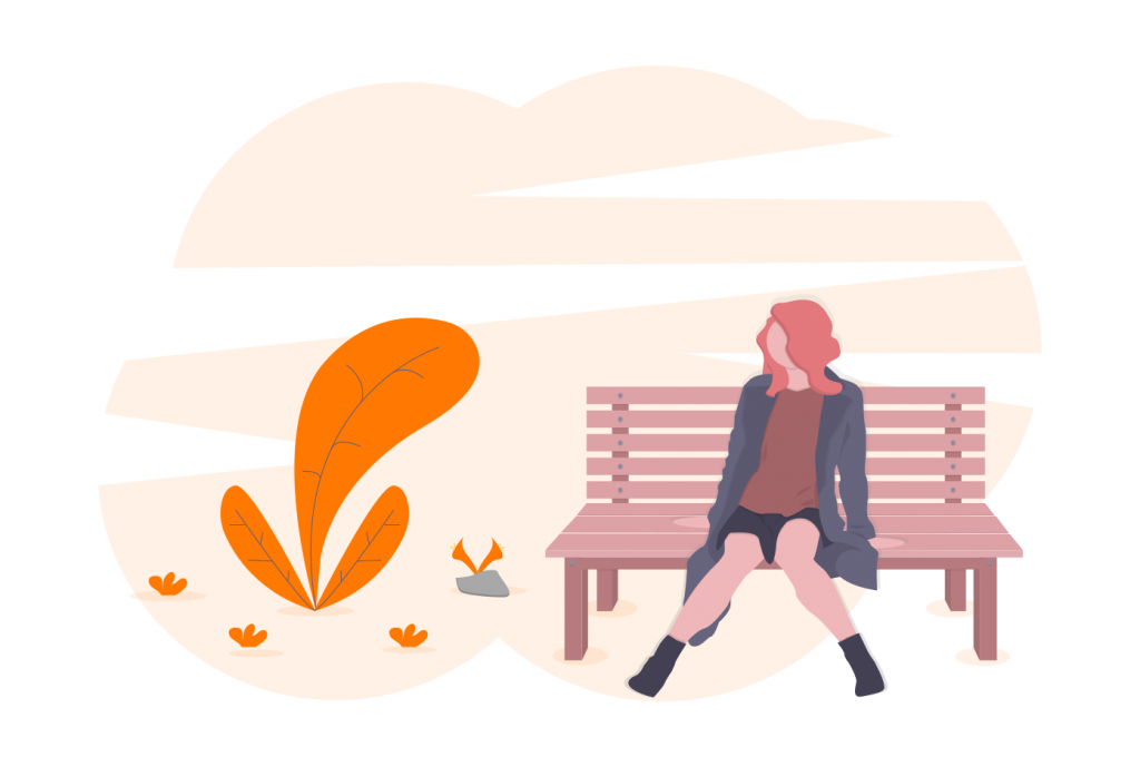 woman sitting on a bench outdoors
