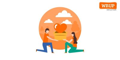 illustrated image of two people kneeling together holding a box with an orange heart in it